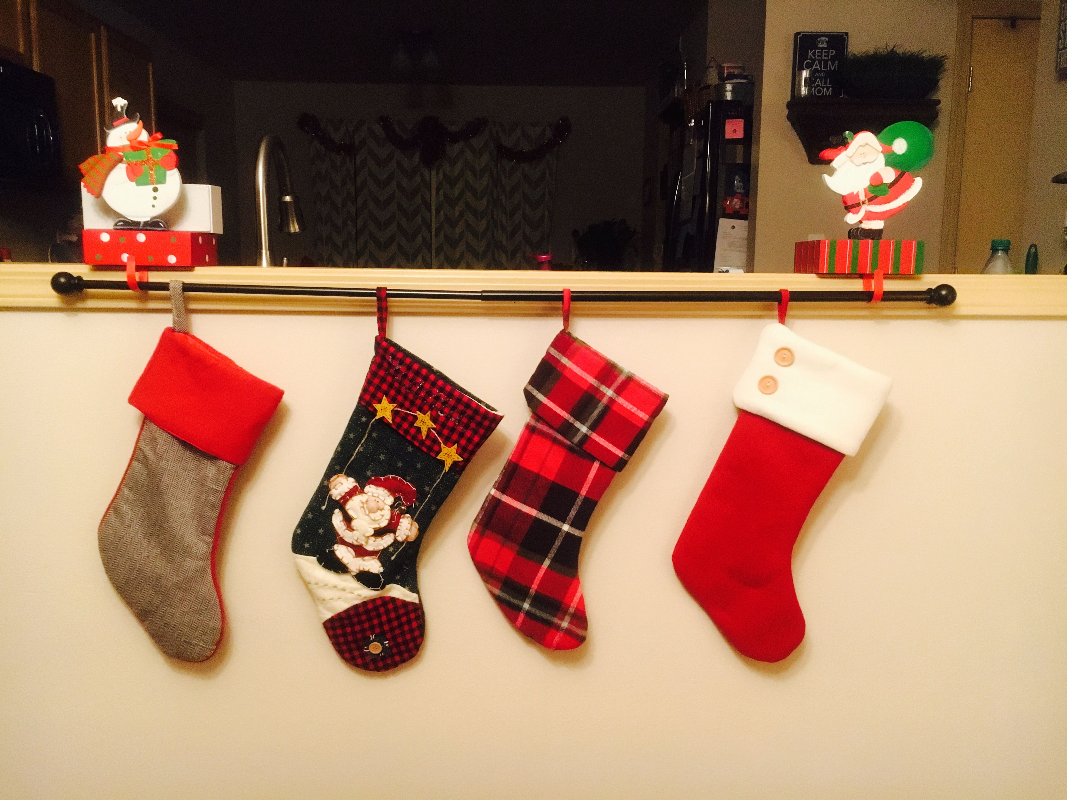 No Fireplace Or Mantle Hang Stockings On A Curtain Rod Using 2 3 Stocking Hangers On Ledge Shelf Or Tv Stand Enter Hanging Stockings Mantle Stocking Hanger