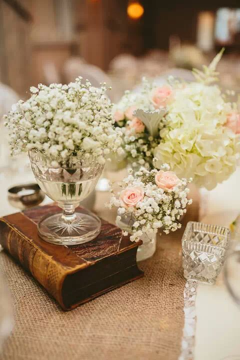 Our vintage books vases and runners look gorgeous for a
