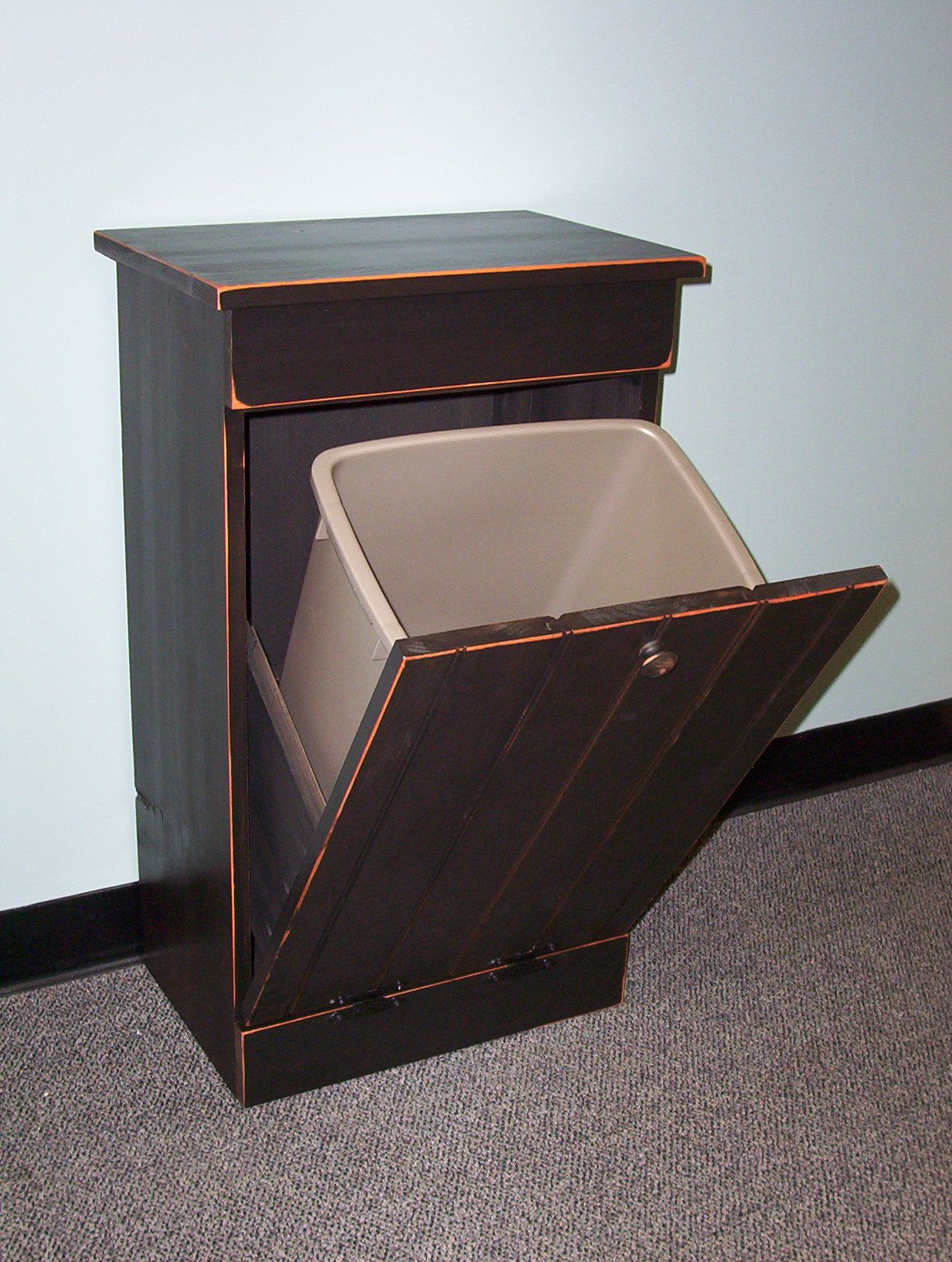 tilt out trash bin!! I need this in a very bad way!! Keep Annie out ...