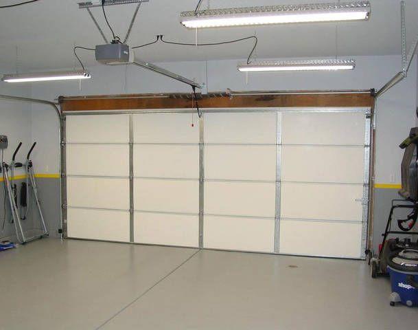 How To Fix Garage Door Spring Tension Garage Lighting Garage Design Garage Doors