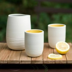 Pigeon Toe signature scribble pattern on straight-sided hand-thrown porcelain cups and interior color of your choice. Shown: two, in yolk.