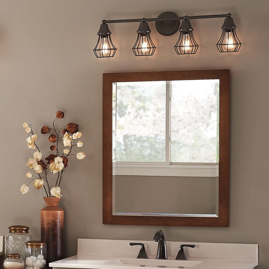 Rustic bathroom lighting - Bring An Element Of Industrial Cool Into Your Bathroom With A Bronze Finish Cage Light