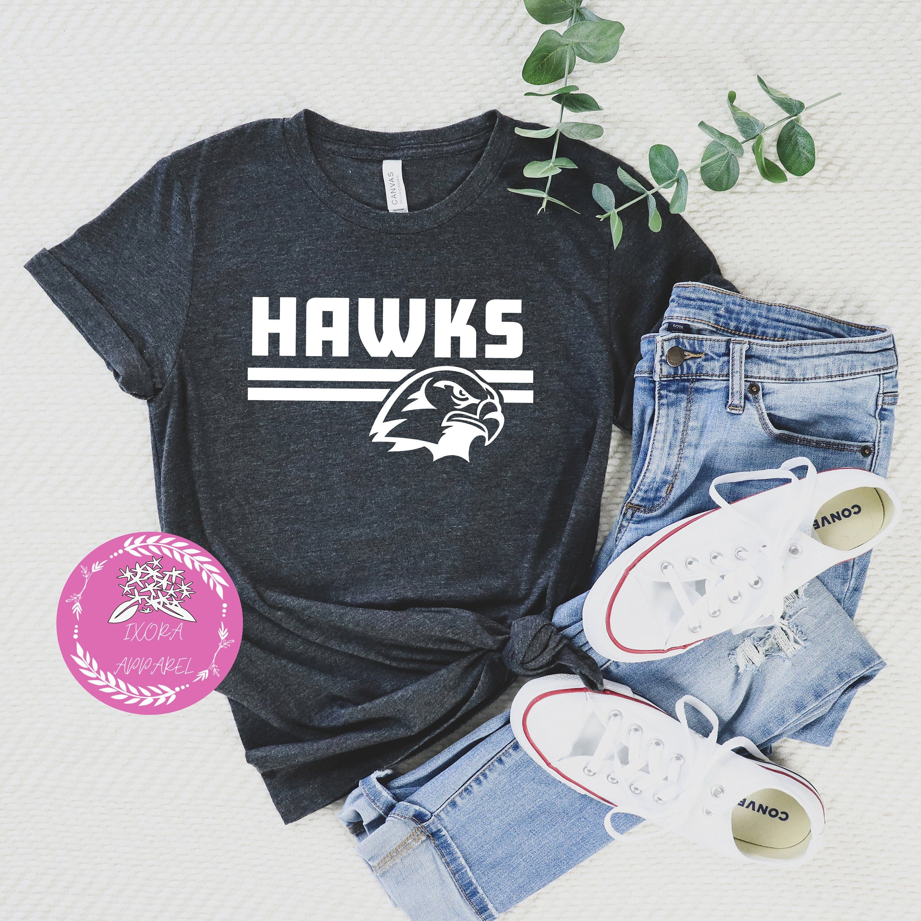 Hawks Shirt, Team Spirit Shirt, Hawks Team Shirt, Hawks Football Shirt, Hawks Fan Shirt, Hawks School Spirit, Hawk Mascot Shirt Welcome to our Etsy store. Please choose the shirt color carefully since they vary each other. Thank you for stopping by. We are happy to provide handmade shirts for you. Now, you can find out our products and details below. If you have any questions please let us know. DISCLAMIER PLEASE READ ALL OF THE DETAILS BEFORE PLACING YOUR ORDER!! How to order: 1. Choose the siz