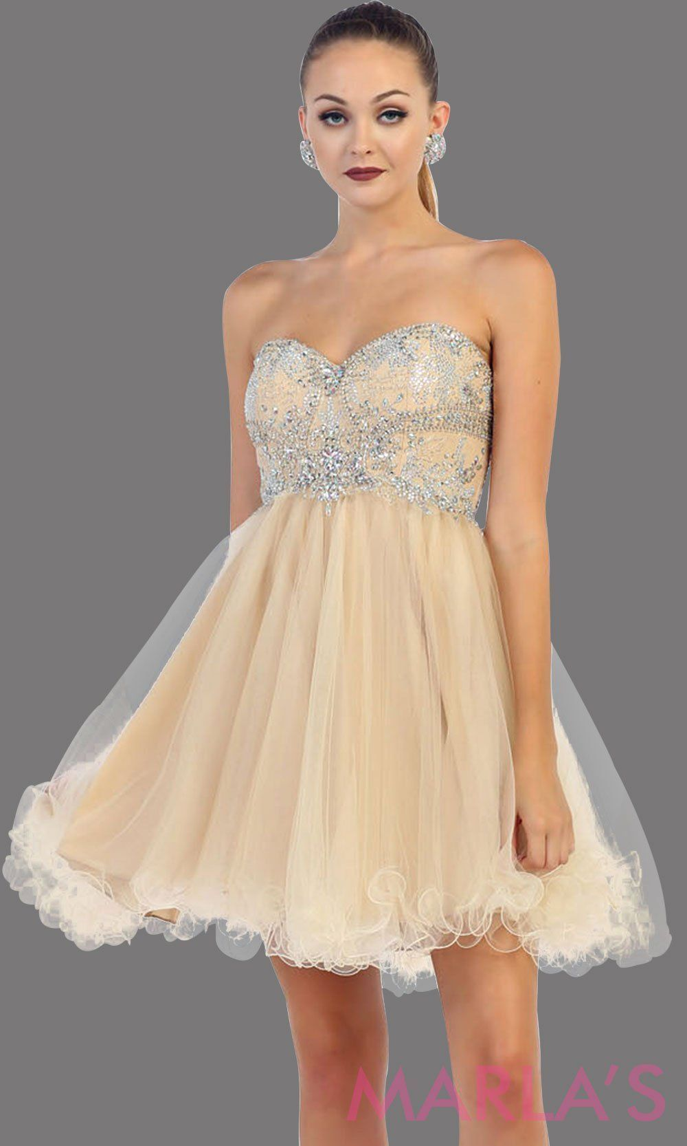 b0253ee8ac475 Short strapless puffy champagne dress. This short light gold grade 8  graduation dress has sequin bodice and corset back. This is perfect for  homecoming, ...