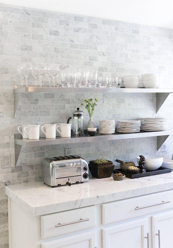 white modern kitchen // marble coutertops and backsplash // Ohara Davies-Gaetano