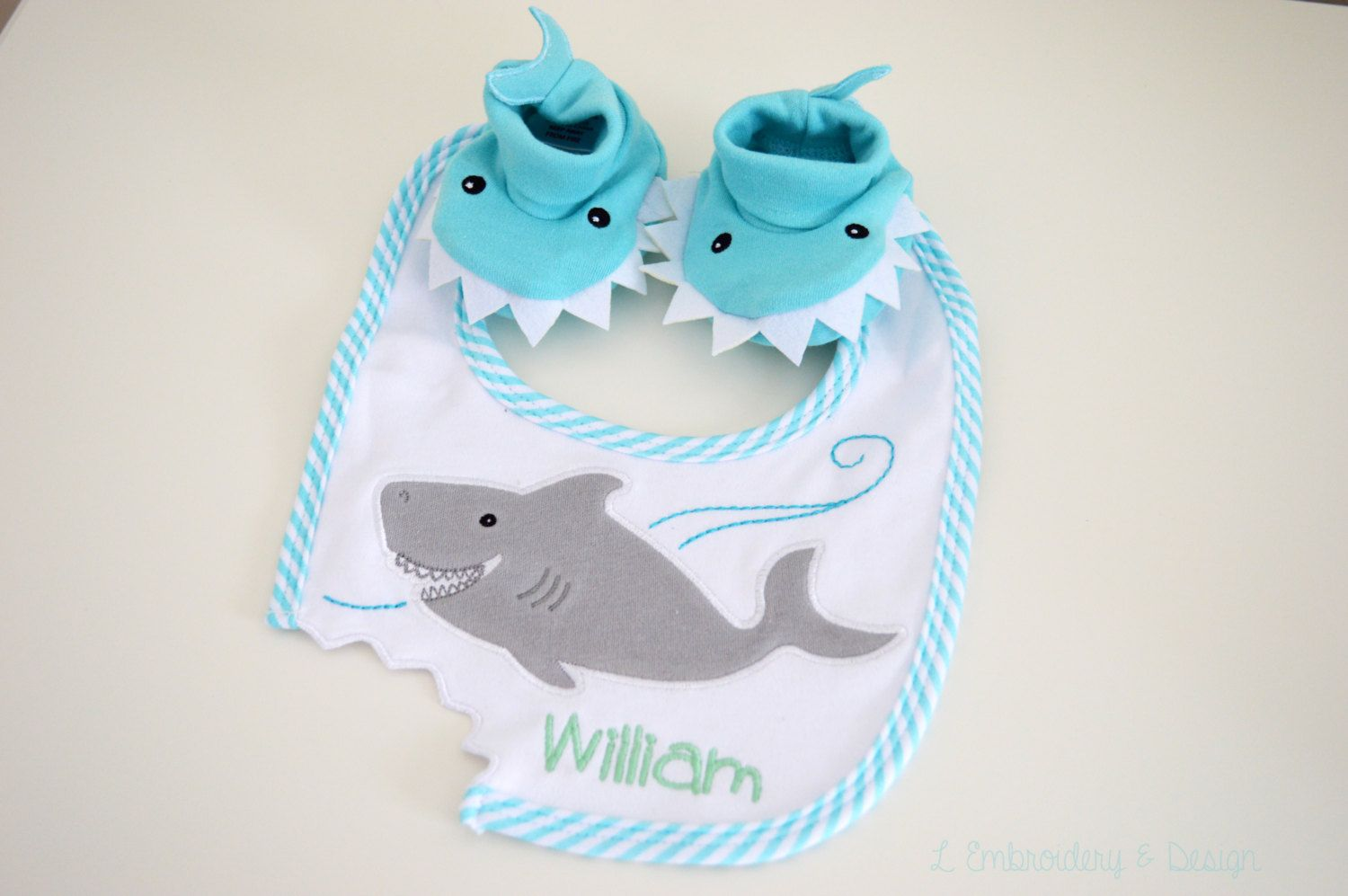 Personalized Baby Shark Bib and Booties Gift Set / Monogrammed Shark Gift Set / Chomp and Stomp Gift Set / Baby Blue Shark Bib and Booties by OysterBayEmbroidery on Etsy https://www.etsy.com/listing/203269968/personalized-baby-shark-bib-and-booties