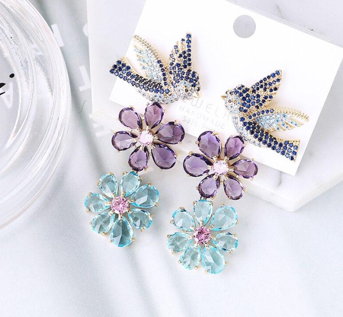 As seen in many fashion magazines, these Luxe Crystal Bird and Flower Drop Earrings are a must-have pair of rhodium-plated earrings that are perfect for you or your best friends!   #britishtatler   #elleuk #ellemagazine #earrings #fashion #jewellery #multicolored #crystalearrings  #giftideas #crystaljewelry #Spring #flowerjewelry #Flowerearrings #flora