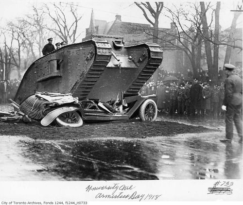 A tank rolling over a car for a public demonstration - [University Ave., Toronto] Canada, 1918 (via Flickr)