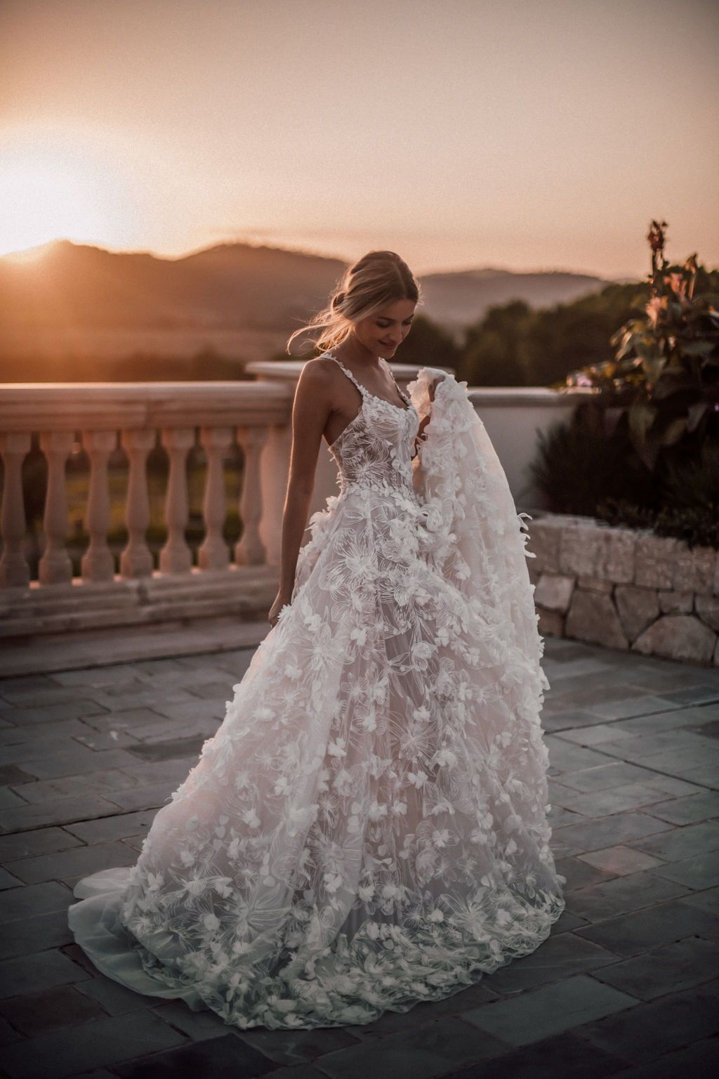 5d3c46c6c28 The  Fabiana ballgown s the perfect choice with its embroidered tulle  adorned with 3D floral embellishments. Photo  by Tali Photography