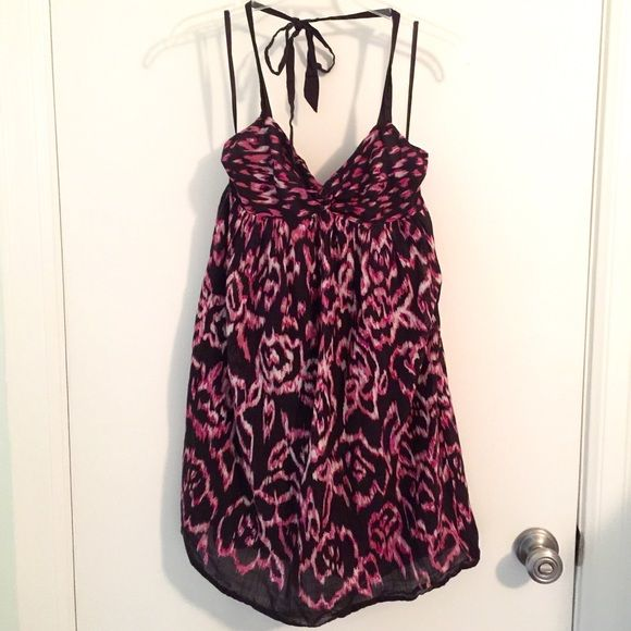 """Ann Taylor Loft Cotton Sundress Purple and Black This dress by Ann Taylor Loft has a rose design print with black, purple and white. The front is a v-neck and has a halter neckline. Dress is 100% cotton and has a black cotton lining to eliminate the need for a slip and keep it from being see-through. Machine washable. Approximate measurements; bust 13"""" across, waist 17"""" across, length from back of dress is 25"""". Side zipper. A great dress to wear to work with a jacket and perfect for a…"""