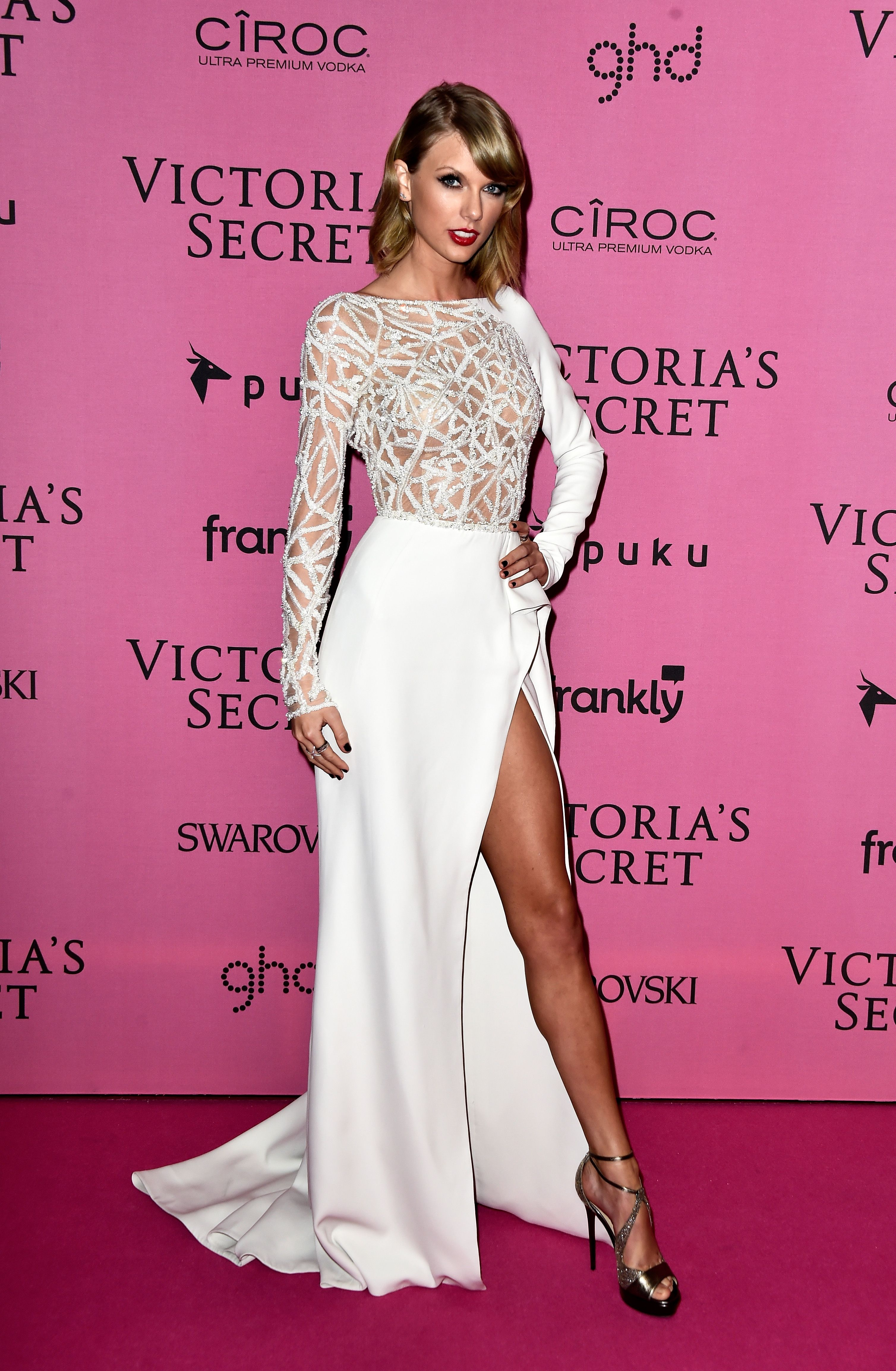 3b00657e12e Taylor poses for pictures on the pink carpet at the 2014 Victoria s Secret  Fashion Show at Earl s Court Exhibition Centre in London on Dec. 2