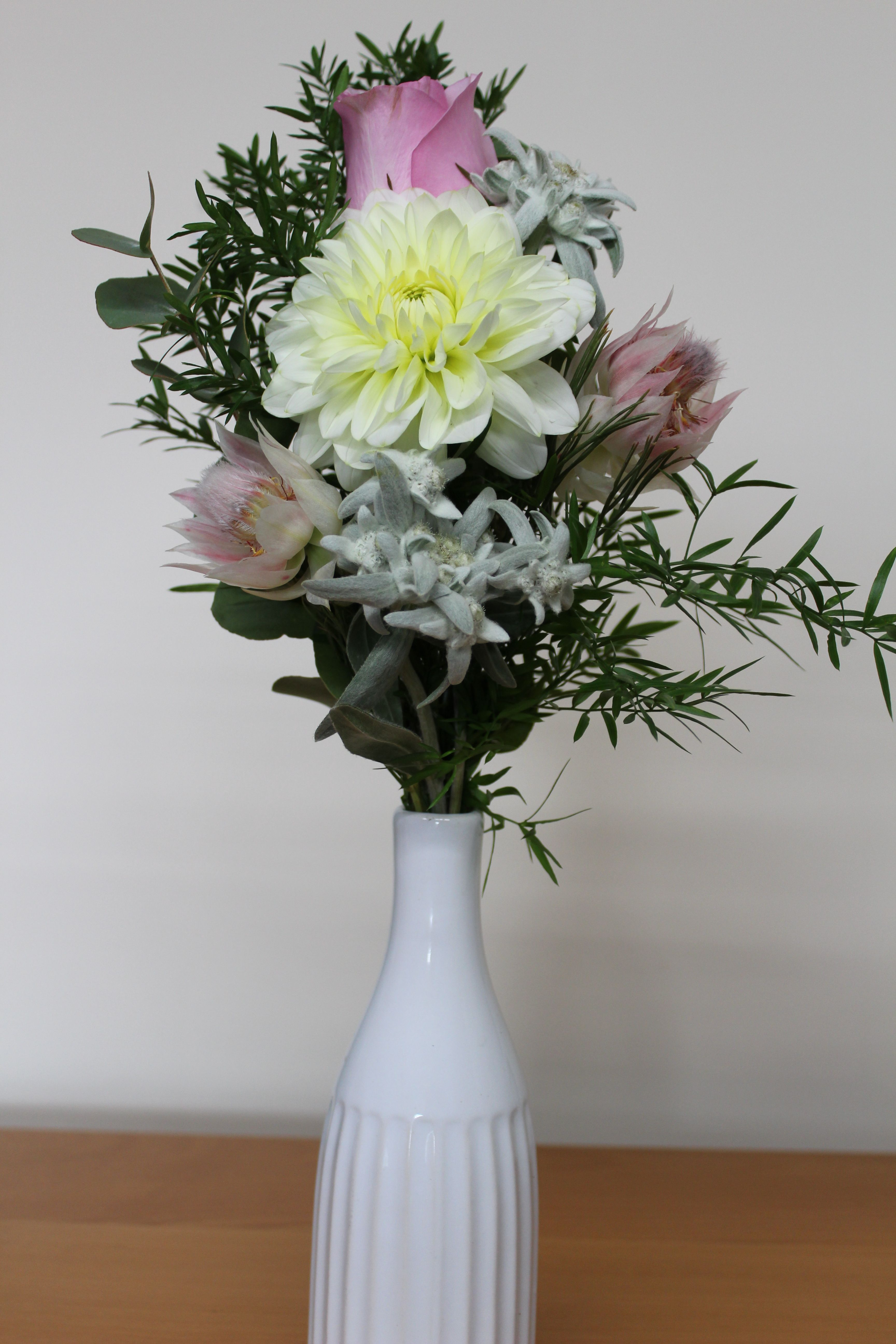 Mothers Day Floral Arrangement In A Ceramic Milk Bottle Style Vase