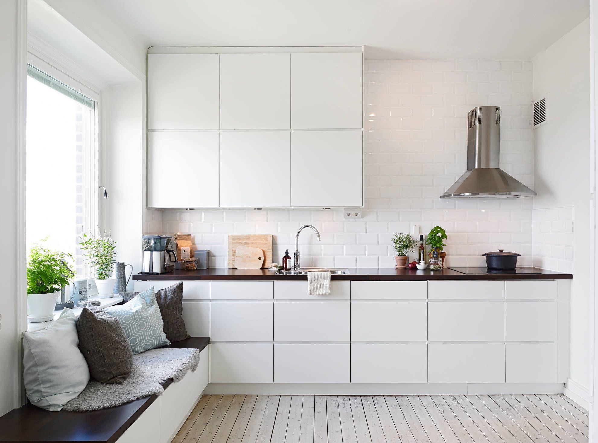 white sleek kitchen, subway tiles