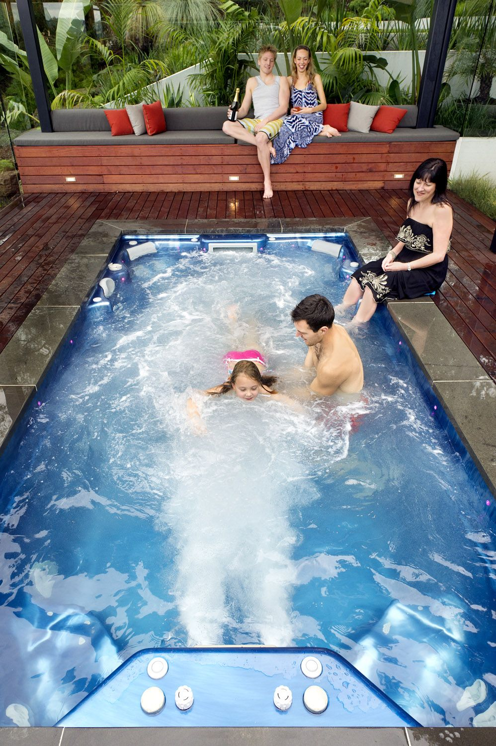 Family playing swimming in an endless swim spa amazing for Swimming spa