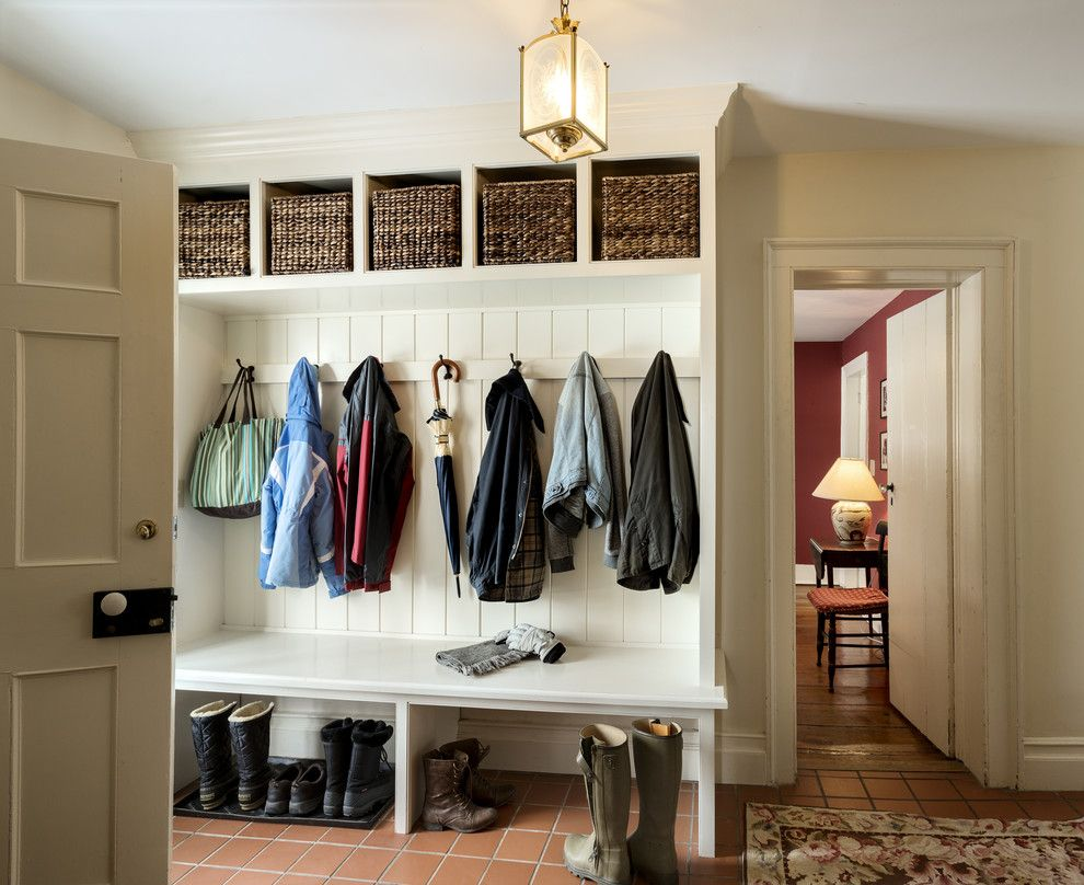 Furniture saving small and narrow entryway spaces with Mudroom bench and hooks