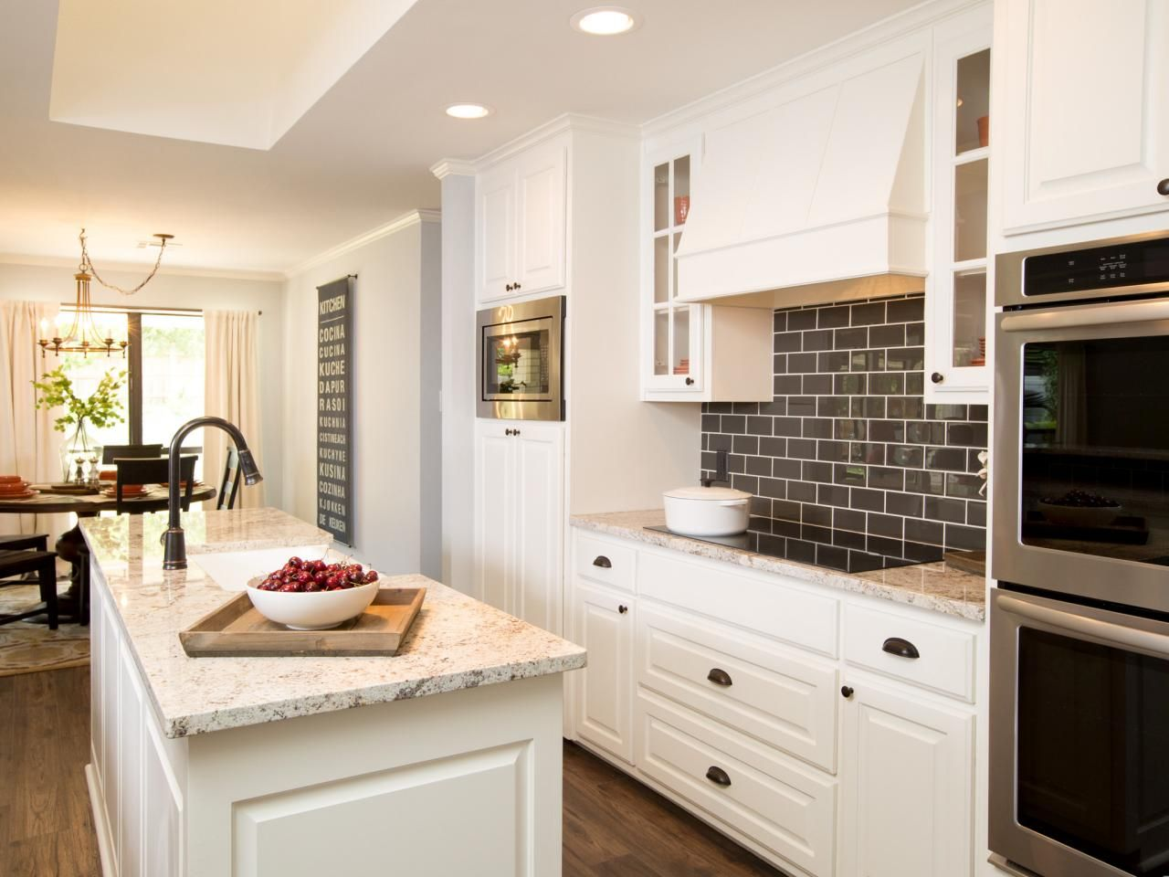 The kitchen opens at one end onto a family dining area with plenty ...
