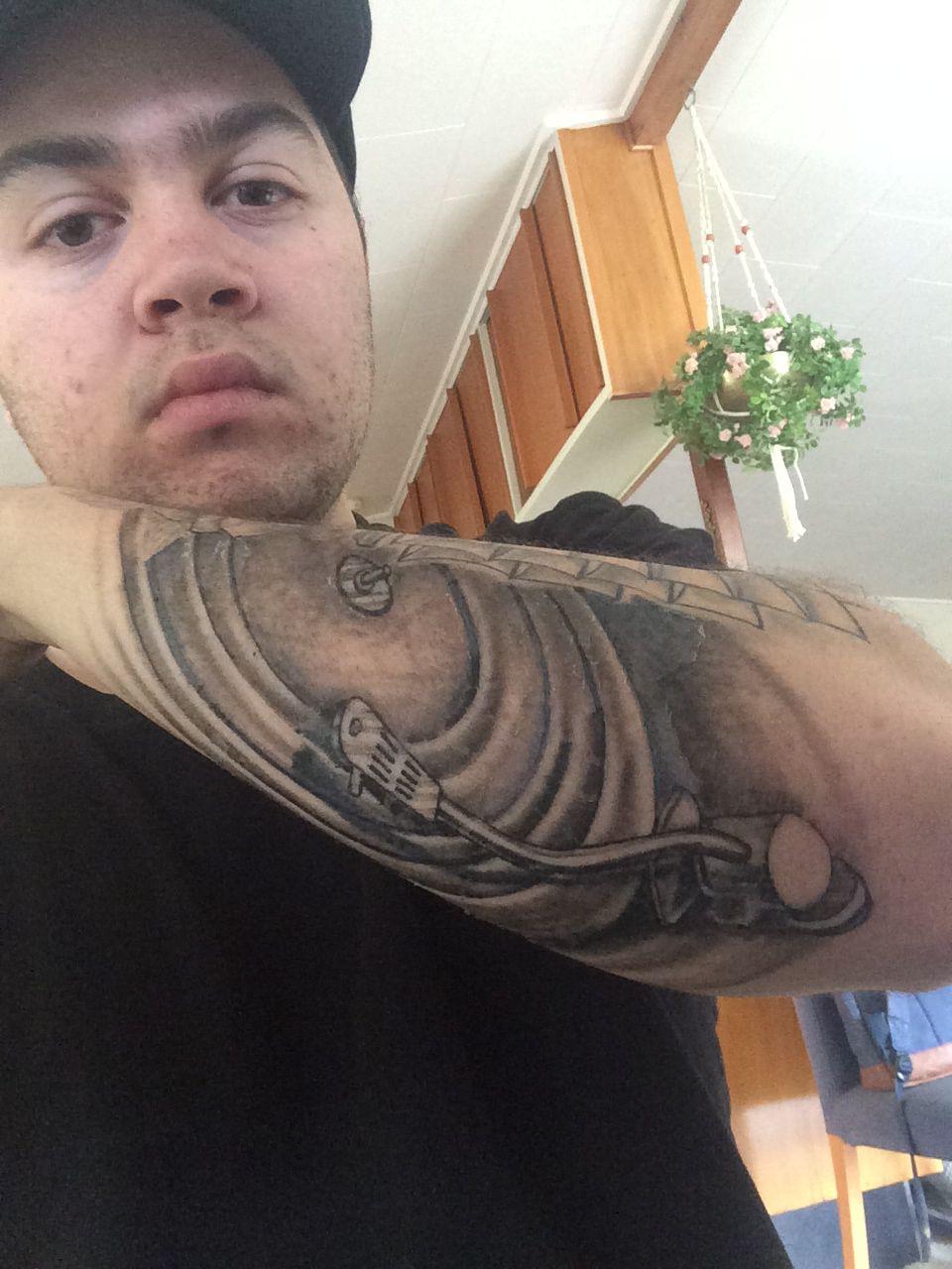 New tattoo last week, starting to peel but still looking