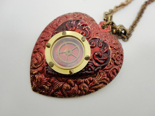 Brassy's porthole heart goes over to the Steampunk Side....while incorporating charming elements at the same time!  Available here:  http://www.etsy.com/listing/92072045/steampunk-heart-necklace-with-porthole?ref=pr_shop