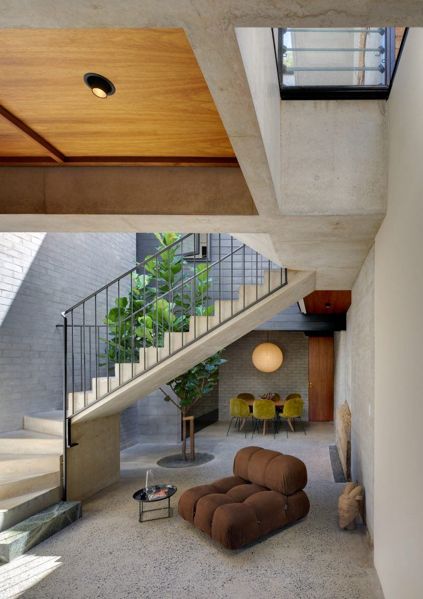 A tree grows up through a lightwell that Australian studio Welsh + Major has added to this house in Sydney, and topped with an opening glass roof.