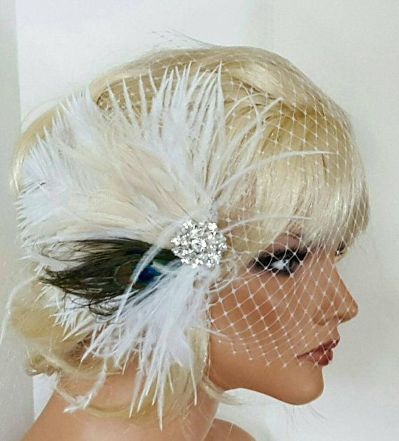 Check out this item in my Etsy shop https://www.etsy.com/listing/262865338/peacock-fascinator-and-french-net-veil
