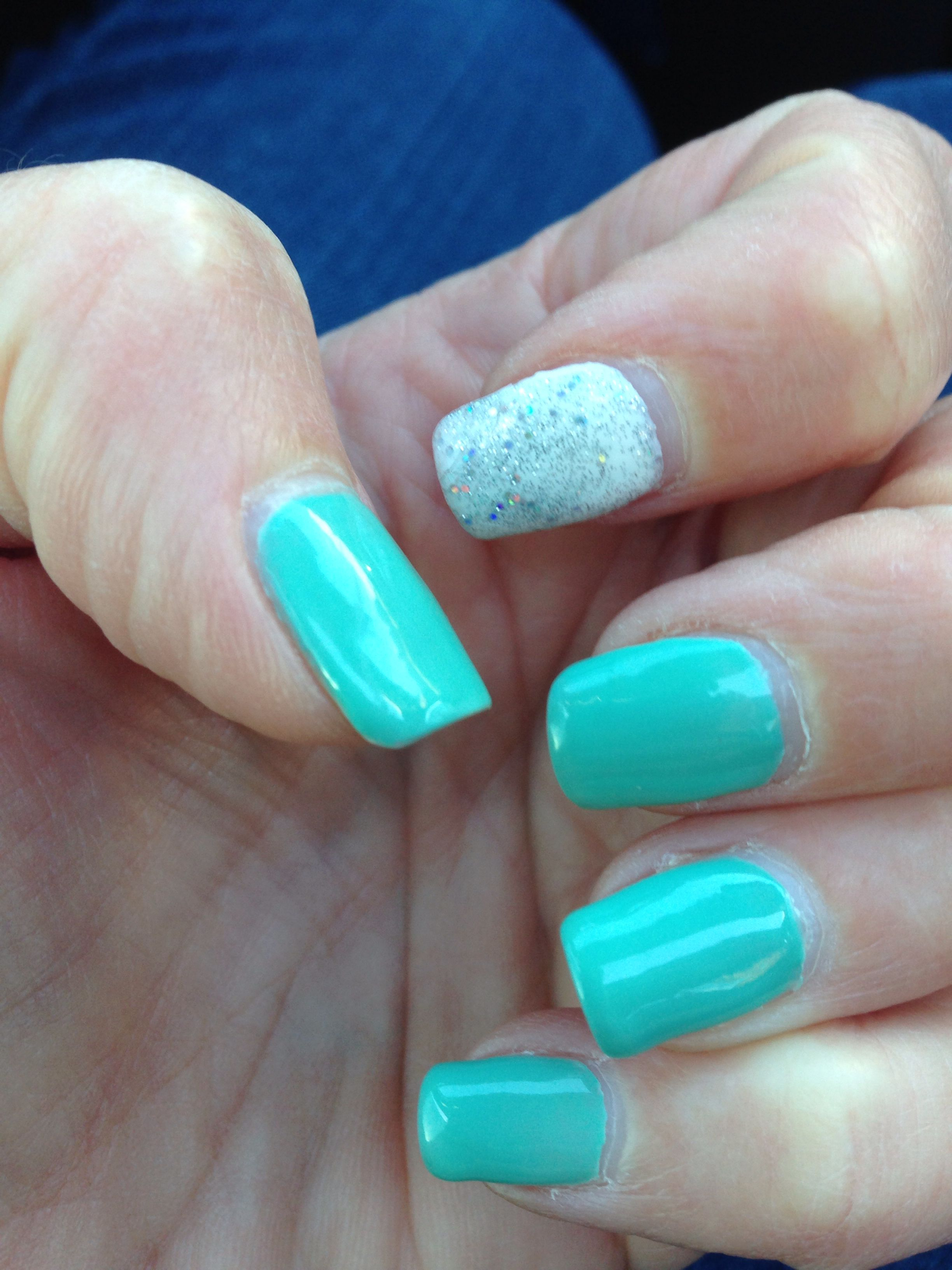 Teal and silver and white nailes