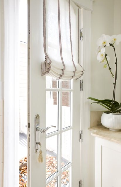 Sally Steponkus Interiors Mudroom Door With Gl Panes Covered In French Vintage Grain Sack Fabric Roman Shade