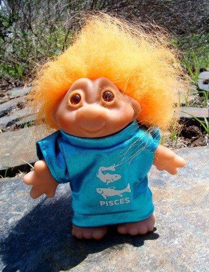 Little Pisces Zodiac Dam troll always seems to me to be patiently waiting for someone to take that oversized shirt off of him. Sorry guy - ain't happenin'.