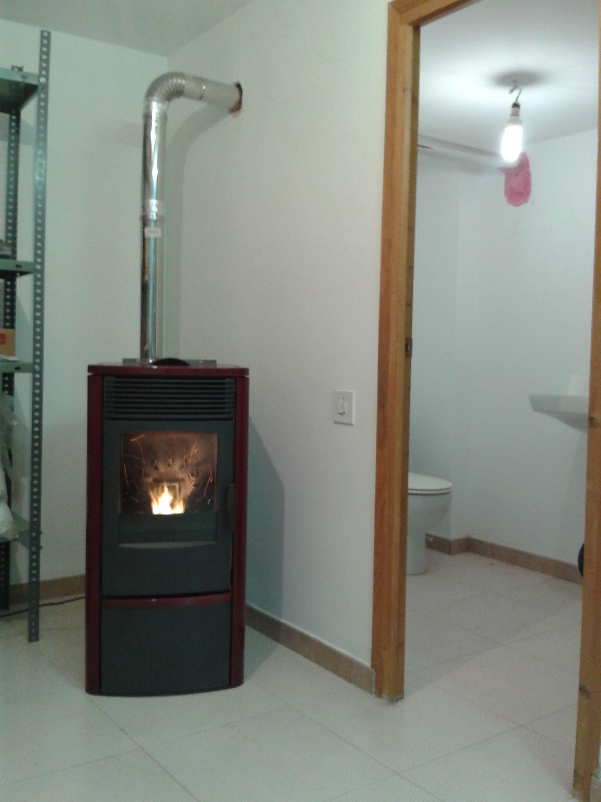 Estufa de pellet edilkamin seven burdeos instalaciones for Caldera de pellets para radiadores
