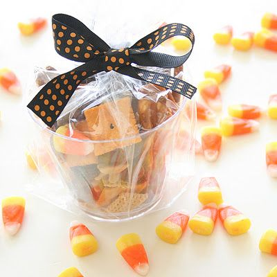Halloween Snack Mix  4 cups Classic Animal Crackers  4 cups Chocolate Animal Crackers  4 Cups Pretzels  4 cups Cheez-its  2 cups Chex Cereal  2 cups Raisins  1 1/2 cups Peanuts  1 cup Candy Corn  1 bag Reese's Pieces