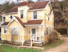 Pale Yellow House With Reddish Brown Roof Pinning Because I M Thinking Of Painting The Awnings On Our New Hou Outdoor House Colors Eureka Springs Brown Roofs