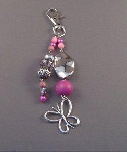 Kleurrijke tassenhanger vlinder te koop in de sieraden webshop van Ekster Jewels.