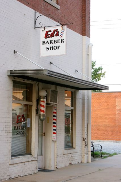 Route 66 Miami Oklahoma barber shop flag barber pole- Photo by Amy Laurel Hegy @A Tale of Two Tramps