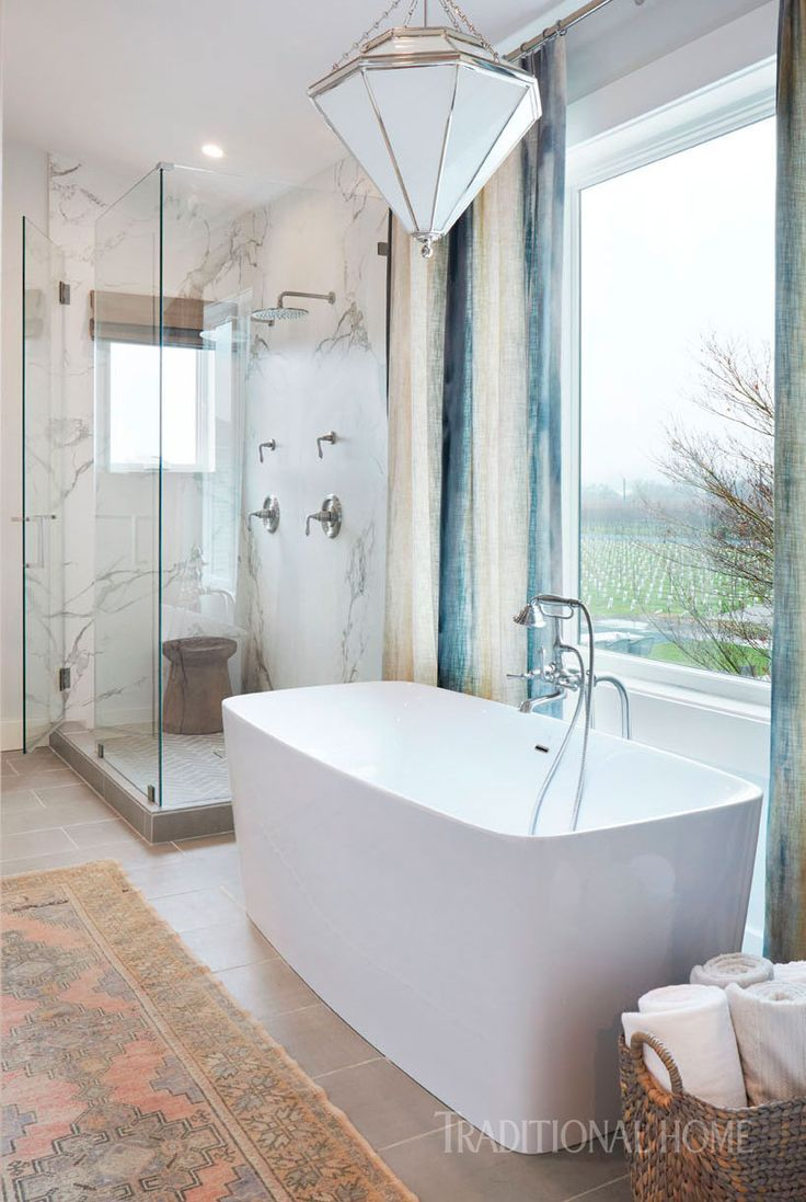 An ideal spot to rest and unwind, the soaking tub with a brushed ...