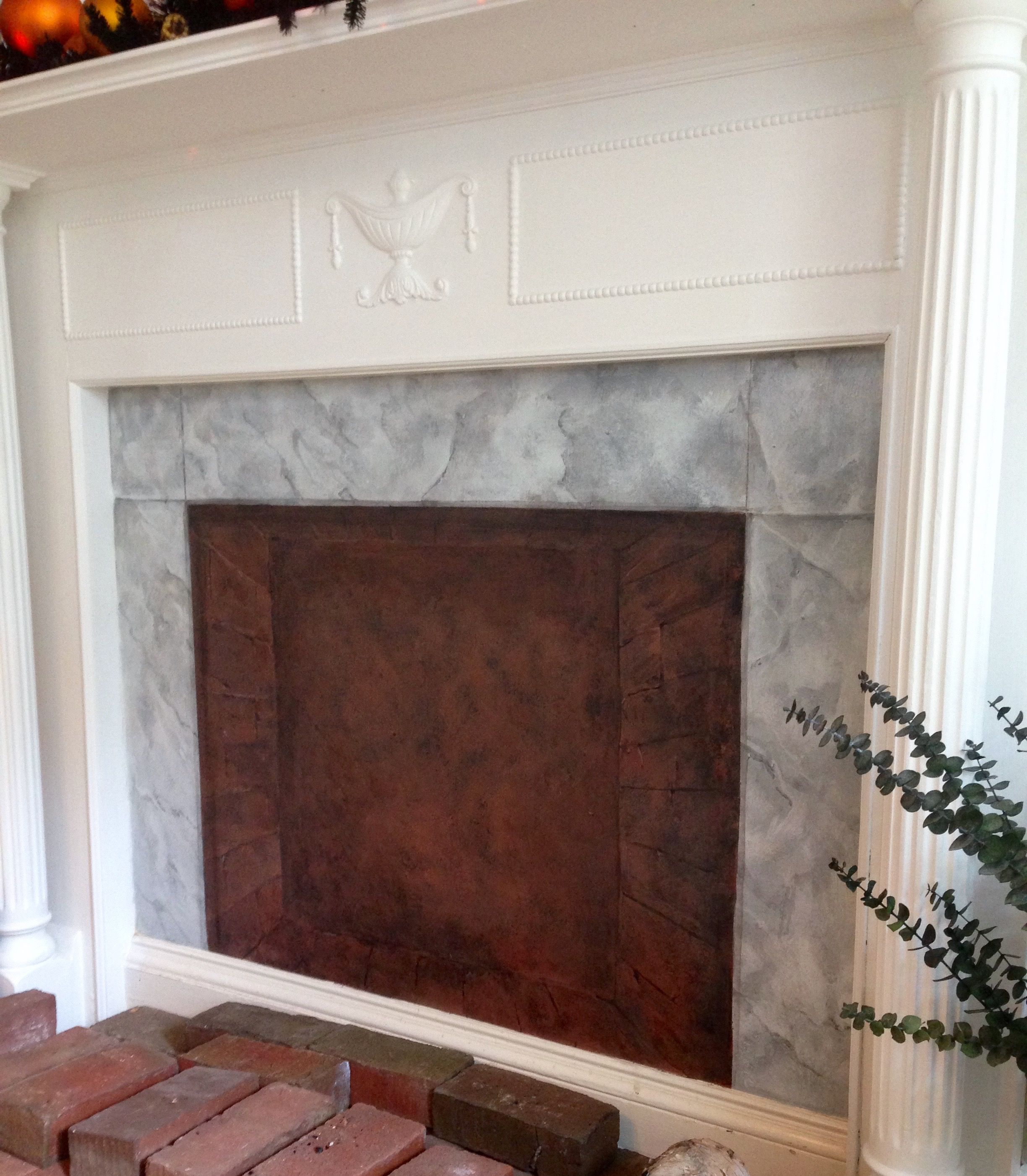 same house as the pillars re did a faux finish to the fireplace