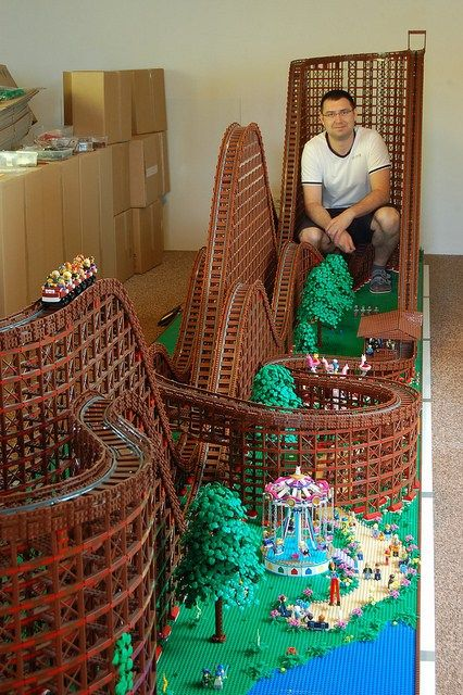 A massive wooden roller coast built entirely out of LEGO