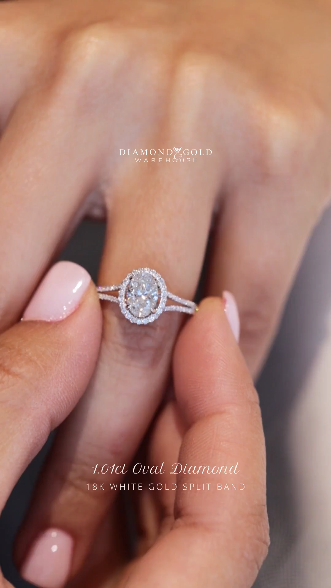 Delicate split in the diamond band gives the illusion of  a larger center oval diamond.