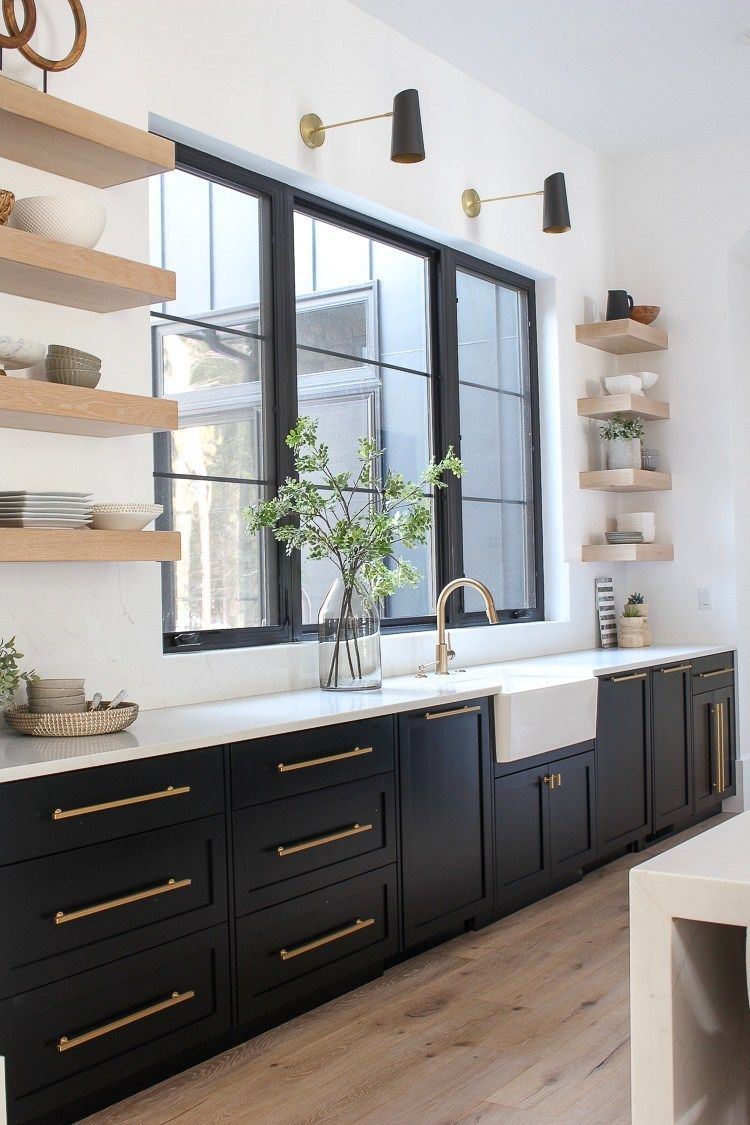 Love the sophisticated look of black kitchen cabinets with white oak floating shelves