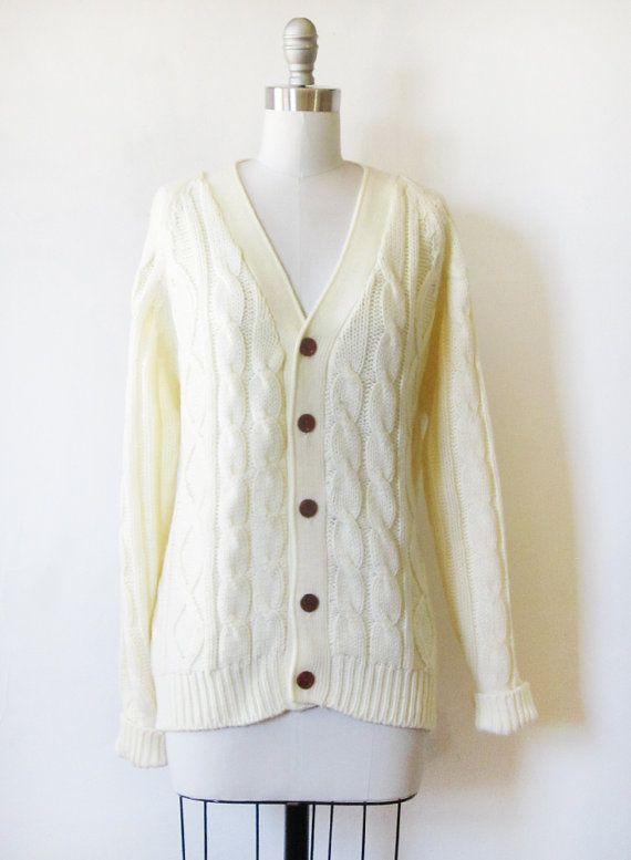 8fe042fc4 Classic 70s vintage cable knit cardigan sweater. Thick creamy knit with  dark wood buttons.