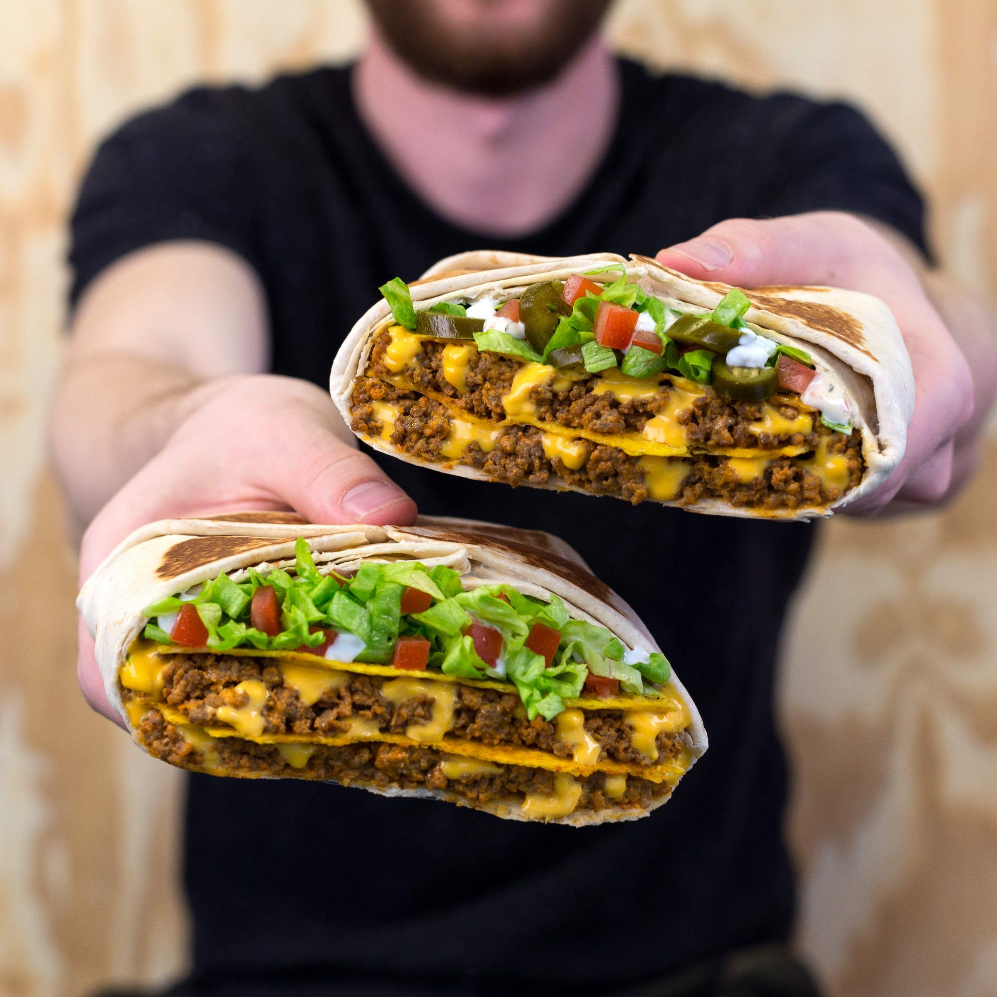 Taco Bell S Enormous Triple Double Crunchwraps Are Back Along With A New Version Mexican Fast Food Food Tacos And Burritos