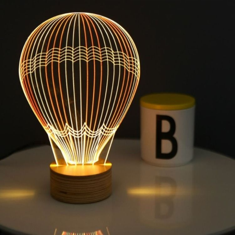Bulbing Is A Fun And Alluring 2d Light By Tel Aviv Based Studio Cheha Laser Engraved Clear A Hot Air Balloon Decorations Hot Air Balloon Air Balloon