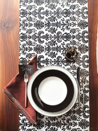 Try this chic trick Lay lengths of graphic black-and-white gift wrap across the table and place plates on top. & 11 Creative Thanksgiving Table Setting Ideas | Linens Thanksgiving ...