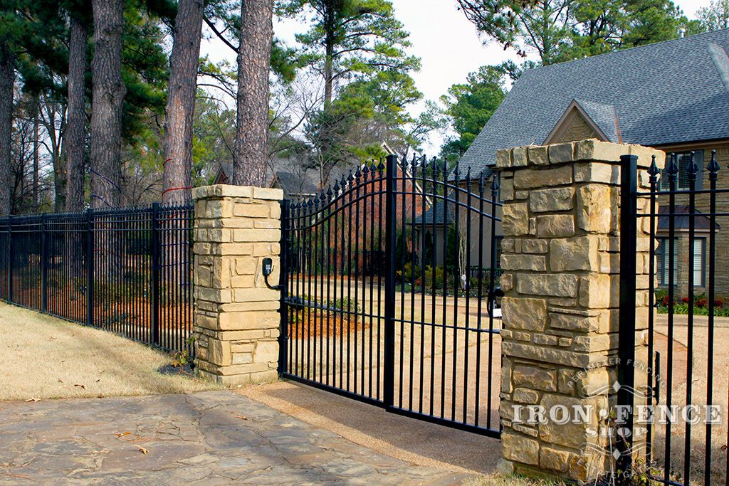 Our arched aluminum and iron driveway gates pair nicely for Aluminum gates for driveways
