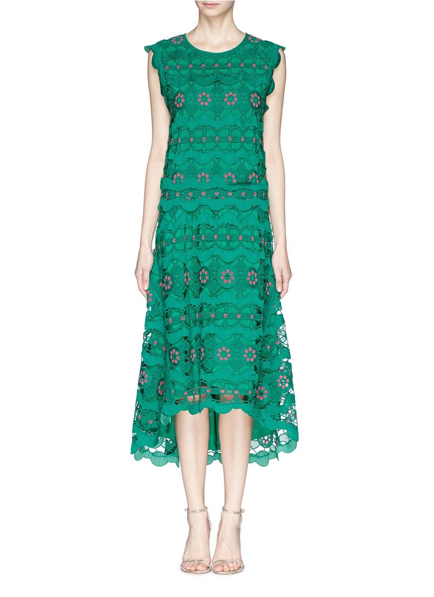 A candidly polished take on resort styling, this dress from Chloé can elevate your sartorial repertoire with effeminate finesse. Adorned with vivid pink embroidery upon a large spring flower guipure lace, this promising version emulates a boxy fit with a relaxed stance to permeate each ensemble with grace and poise.