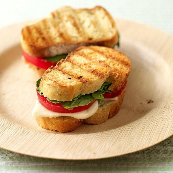 We give these sandwiches extra flavor by rubbing the bread with a cut garlic clove. Swap basil for the arugula if it's too peppery for your taste. #recipe #WWLoves #LoseForGood