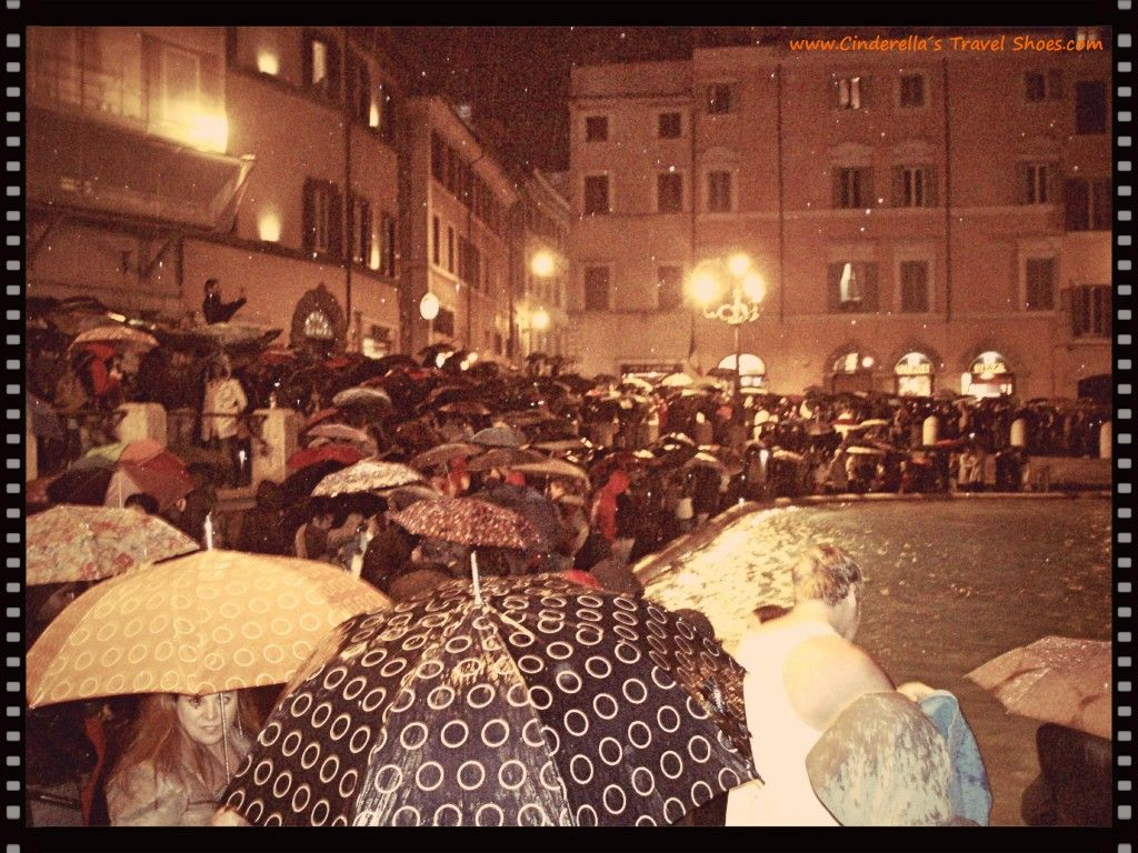 Umbrellas in front of Fontana di Trevi, Rome in Italy