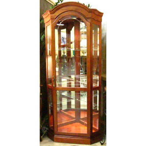 Lighted Corner Curio Cabinet $650. Lighted corner curio cabinet features  arched top, door with - Lighted Corner Curio Cabinet $650. Lighted Corner Curio Cabinet