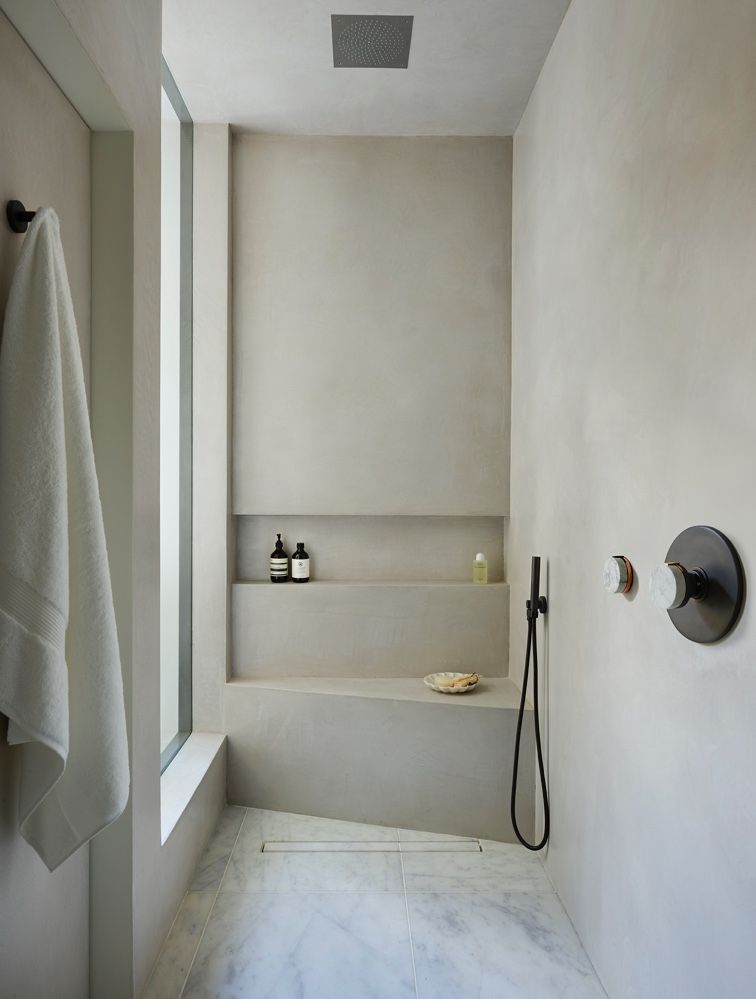 RT Interiors's luxurious wet room using tadelakt, marble flooring and The Watermark Collection's Elements shower set in Oil Rubbed Bronze, Polished Copper and Carrara Marble Handle. Architects: Studio MCW . . #showerroom #bathroomideas #thewatermarkcollection #brassware #showerroom #interiordesignideas #interiorarchitecture #archilovers #wetrooms