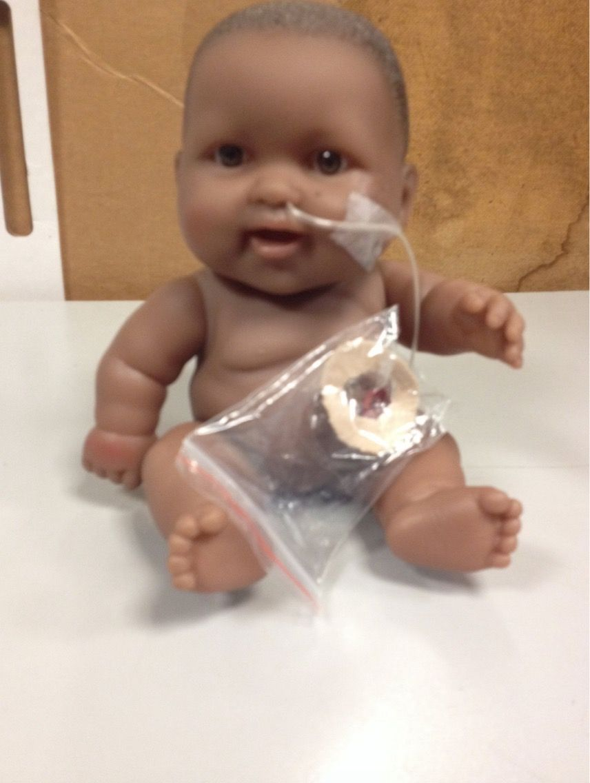 This baby doll demonstrates breathing through a tube and