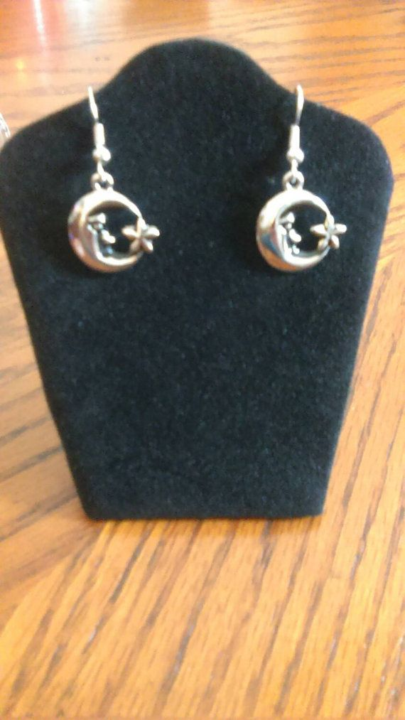 Check out this item in my Etsy shop https://www.etsy.com/listing/217844625/moon-and-stars-dangle-earrings