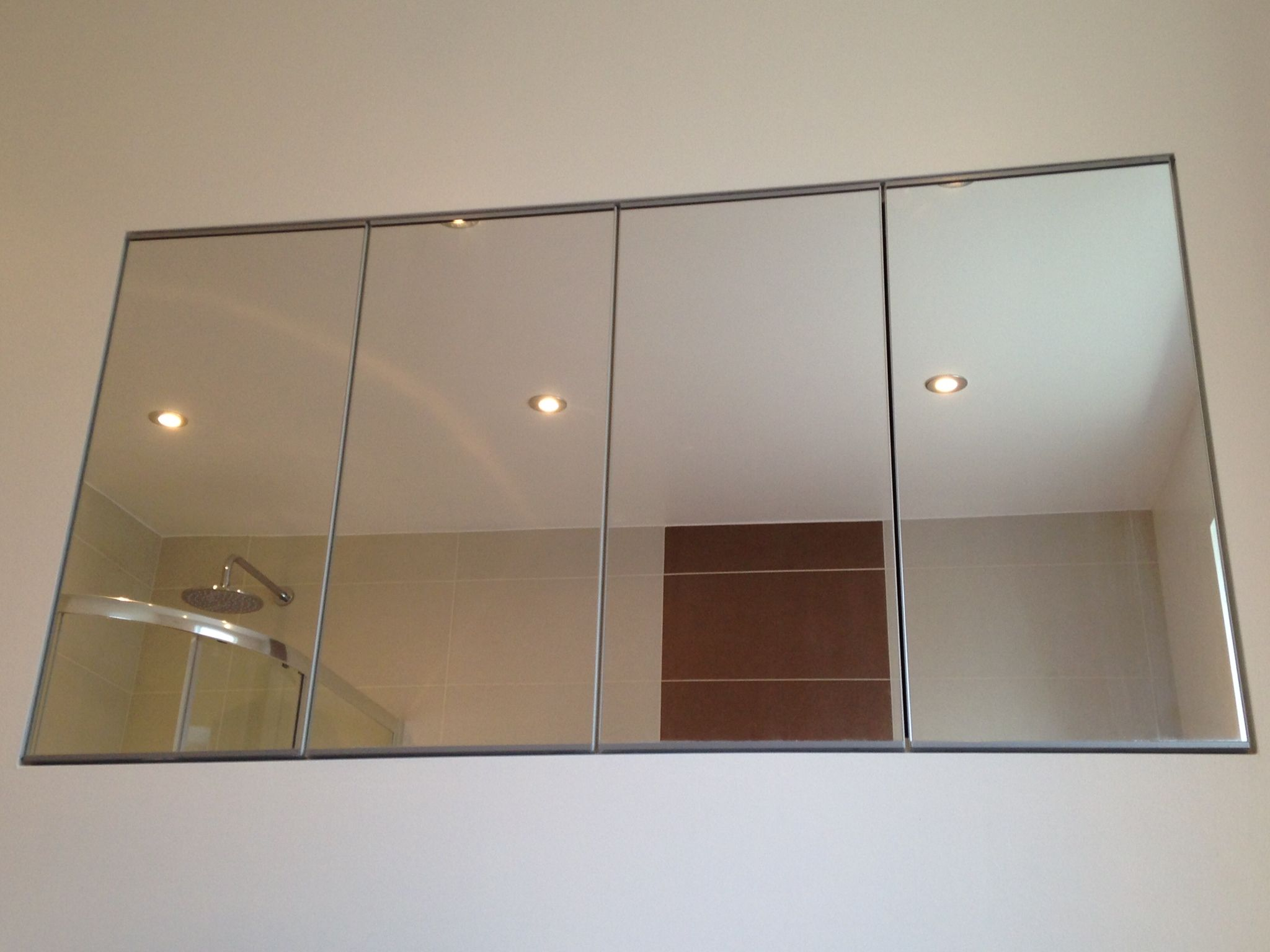 Ikea Cupboards A Pair Of Ikea Mirrored Cupboards Are Recessed Flush With